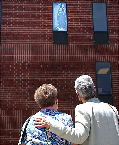 A third floor window, where visitors believe they see a white apparition of the Virgin Mary, is seen at Milton Hospital in Milton, Mass.